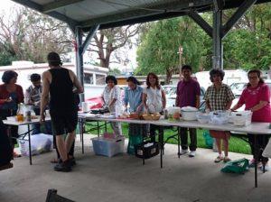 Distributing food for homeless-min