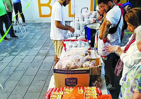 Spain serving needy3